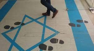 صورة النقابات المهنية: سنرسم علمًا جديدًا للاحتلال ردًا على احتجاج تل أبيب